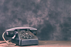 Old black phone on wooden table Royalty Free Stock Photography