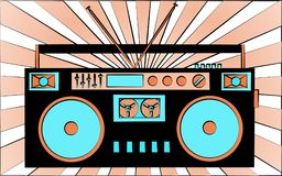 Old black retro vintage antique hipster obsolete cassette music audio tape recorder against the background of orange rays Royalty Free Stock Images