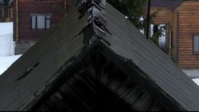 Old black roof in rainy weather. The action in real time stock footage