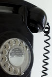 Old black rotary telephone Stock Photos