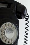 Old black rotary telephone Stock Photos