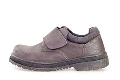 Old black safety shoe for worker Stock Photo