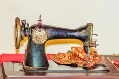 Old black sewing machine for antique or vintage collector. Antique & Vintage Sewing Machines Royalty Free Stock Photo
