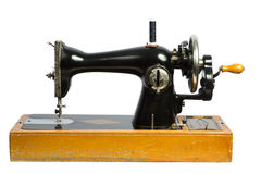 Old black sewing machine isolated ob white Royalty Free Stock Photo