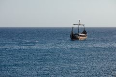 Old black ship in the open sea. Background with copy-space Royalty Free Stock Images