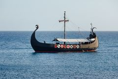 Old black ship in the open sea. Background with copy-space Stock Photo