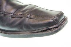 Old black shoe Stock Images