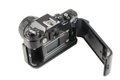 Old black SLR camera with open back cover Royalty Free Stock Photography