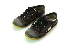 Old black sneakers isolated on white background Stock Photo