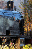 Old black steam locomotive. Detail of a old black steam locomotive stock images
