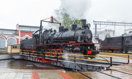 Old black steam locomotive in Russia Stock Images