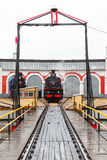 Old black steam locomotive in Russia Stock Photography