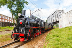 Old black steam locomotive in Russia Stock Photos