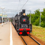 Old black steam locomotive in Russia Royalty Free Stock Photography