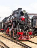 Old black steam locomotive in Russia Royalty Free Stock Photos