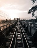 Old black steel train bridge Lampang Thailand to Chiangmai Thail. And in the evening with blue sky cloud and sun, Black White Picture Royalty Free Stock Images