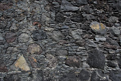 Old black stone wall Royalty Free Stock Images
