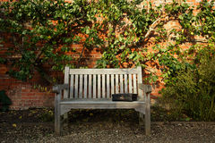 Old black suitcase on wooden bench Stock Image