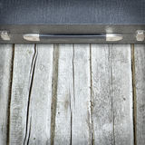 Old black suitcase on the wooden floor Stock Photography