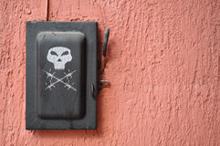 Old black switch - lever with painted skull Royalty Free Stock Photography