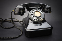 Old black telephone Stock Image