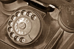 Old black telephone. An old dirty black telephone stock image