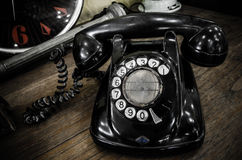 Old black telephone. With rotary disc Royalty Free Stock Image