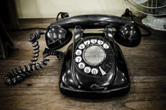 Old black telephone. With rotary disc Stock Photos