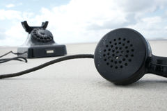 Retro vintage phone on the beach. Old black telephone on the beach Royalty Free Stock Photos