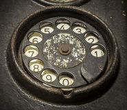 Old black telephone. Close-up of a rotary dial stock image