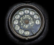 Old black telephone. Close-up of a rotary dial stock photo