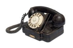 Old black telephone Stock Images