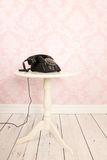 Old black telephone. In vintage room Royalty Free Stock Photo