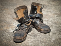 Old black top boot. On floor Royalty Free Stock Image