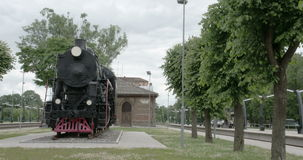 An old black train in a display FS700 4K RAW Odyssey 7Q Stock Image
