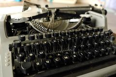 Old black typewriter with round keys. View Stock Images