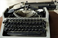 Old black typewriter with round keys. View Stock Photos