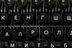 Old black typewriter with round keys. View Royalty Free Stock Photos