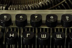 Old black typewriter with round keys. View Stock Image