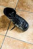 Old black used shoe Royalty Free Stock Photos