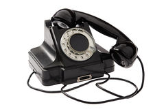 Old black vintage rotary style telephone Stock Images
