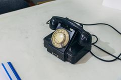 Old black vintage Soviet phone on white table royalty free stock photos