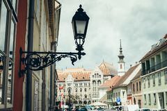 Old black vintage street lapm on the building in Budapest, Hungary. stock photo