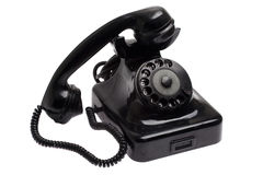 Old black vintage style telephone off the hook. Isolated over a white background Stock Photo