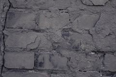 Old black wall. Brick background. Grunge stock photography