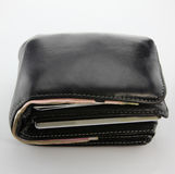 Old black wallet with credit cards and banknote. Old black wallet with credit cards, banknote with white background Royalty Free Stock Photos