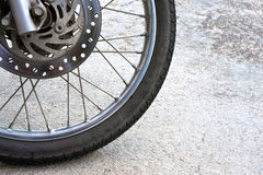 Old black wheel of motorcycle and disc brake Royalty Free Stock Image