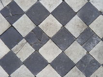 Old black and white block tiles. Royalty Free Stock Images