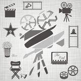 Old colorful movie camera. Old black and white movie camera with movie icons on retro background Stock Photos