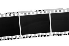 Old black and white photographic film. Old film camera on white background Royalty Free Stock Images